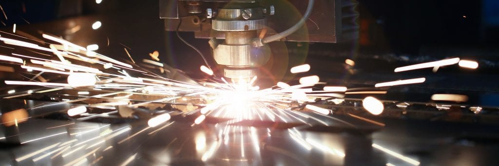 CNC machining with sparks shooting out
