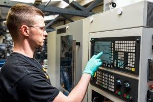 Man programming CNC machine