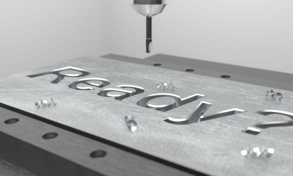 """CNC mill engraving the word """"Ready"""" into a metal plate"""